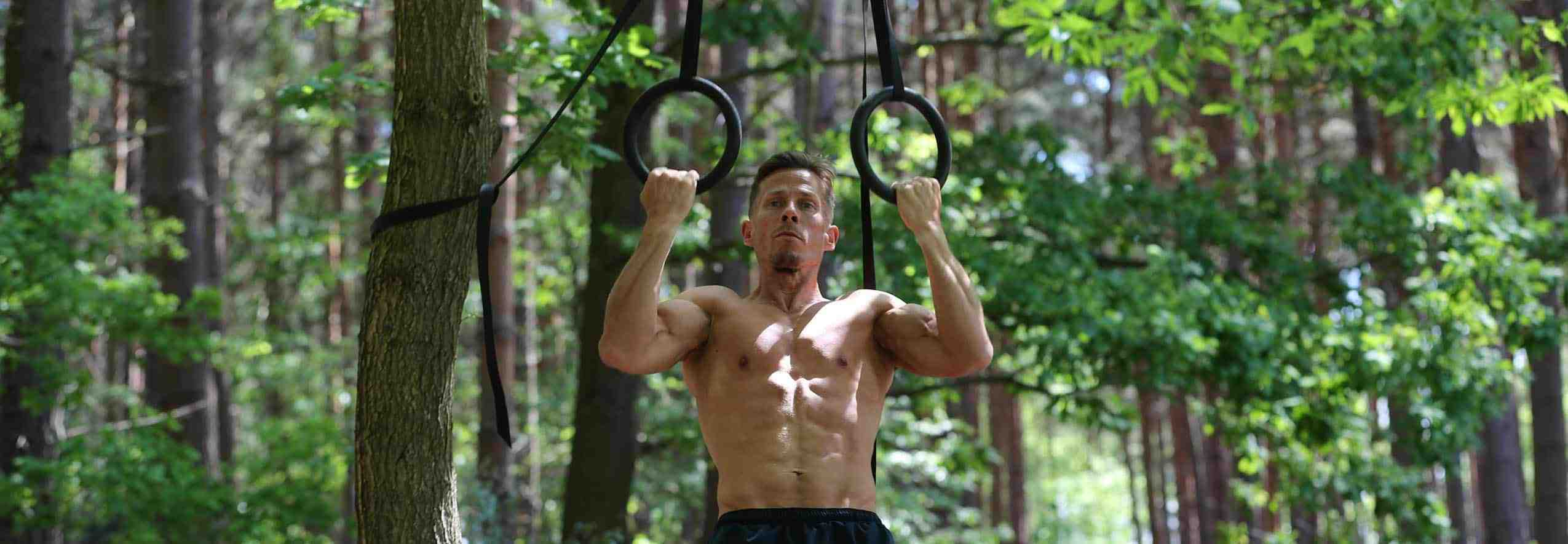 Athlete male man work out with rings