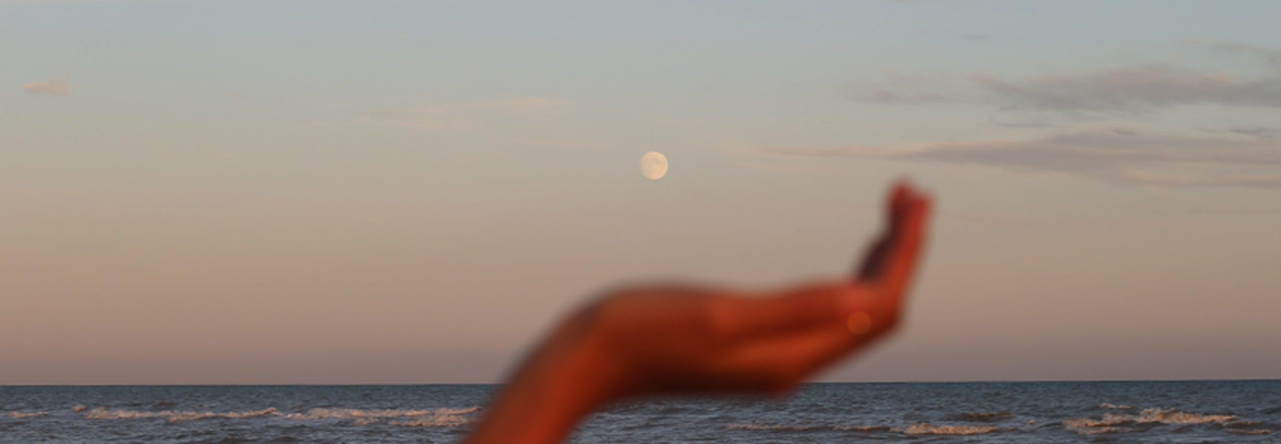 blurred hand sea horizon