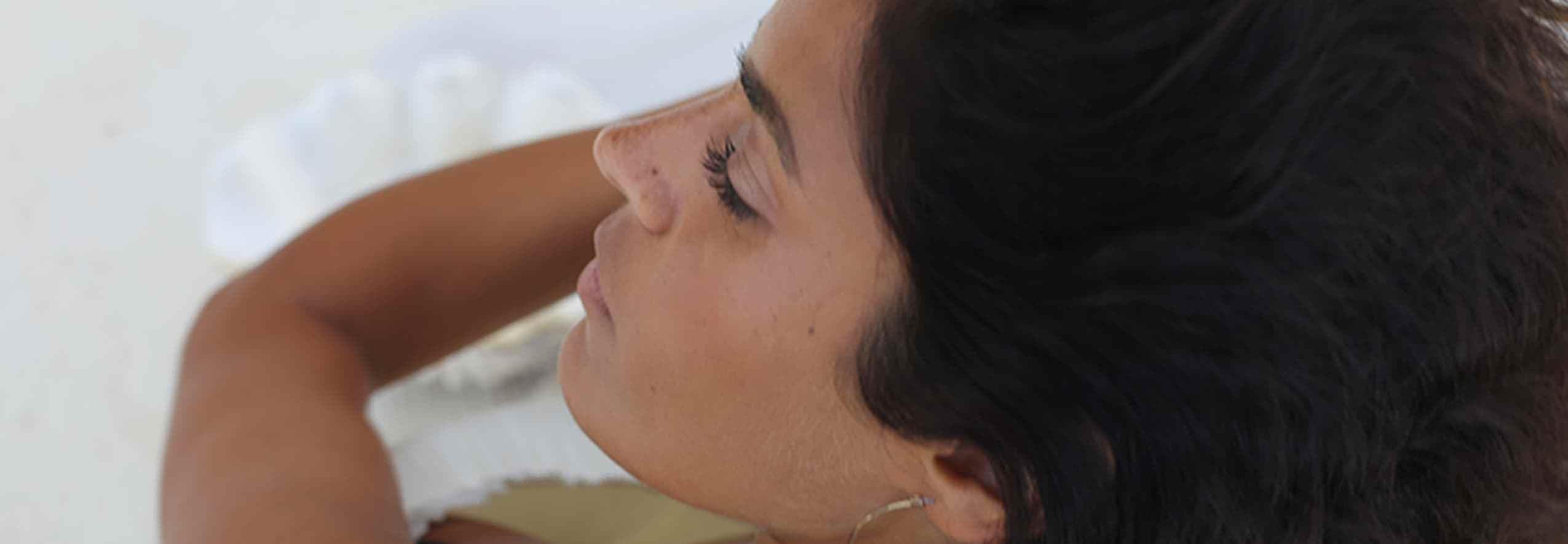 woman near sea shell