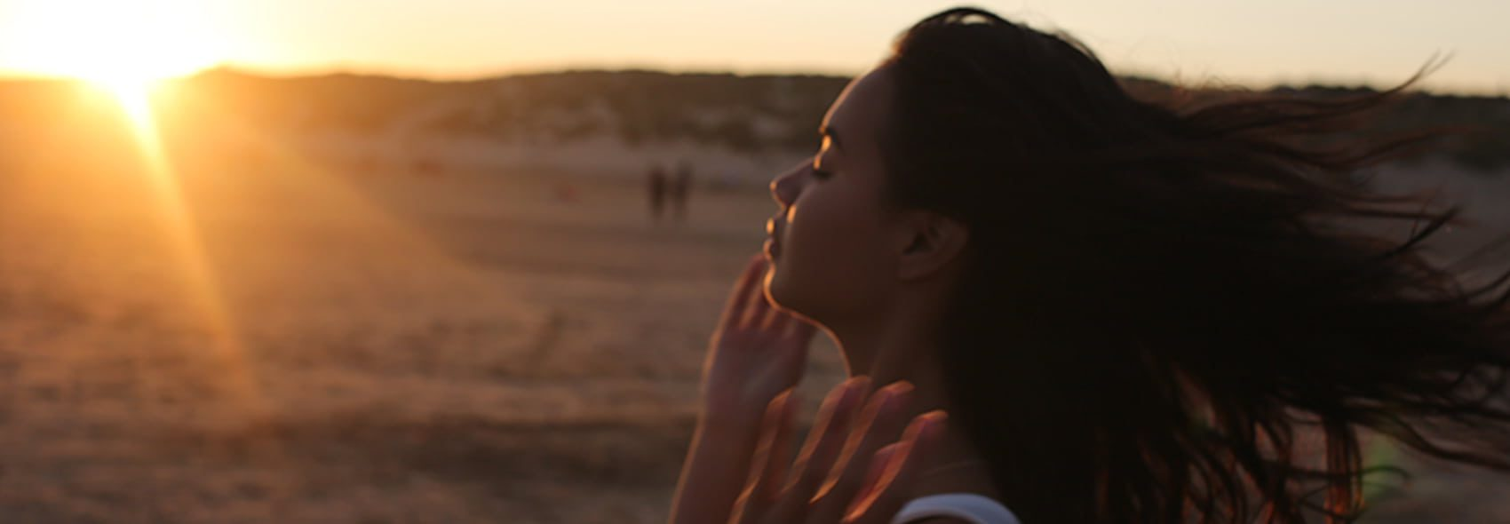 Destressed woman and sunset