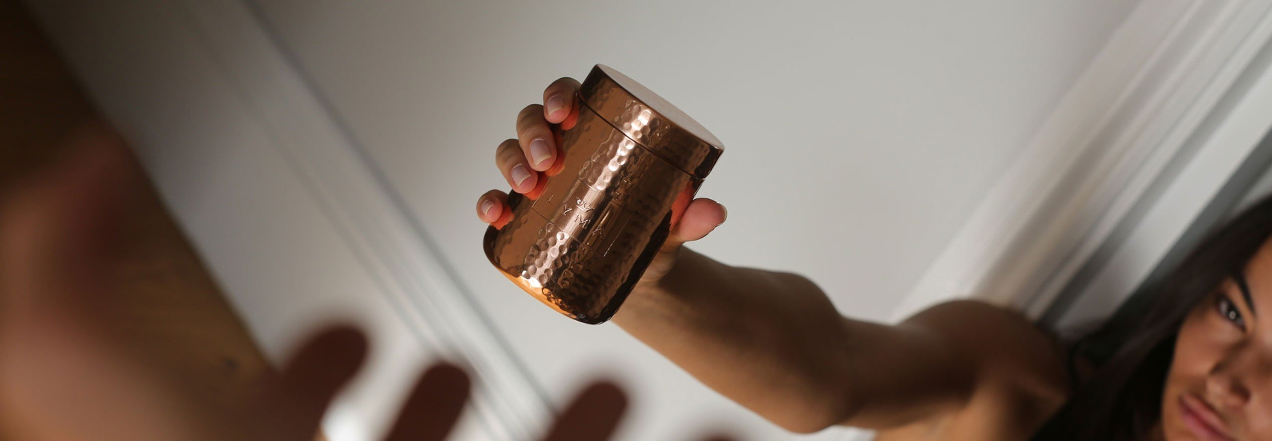 Lady holds LYMA supplements vessel