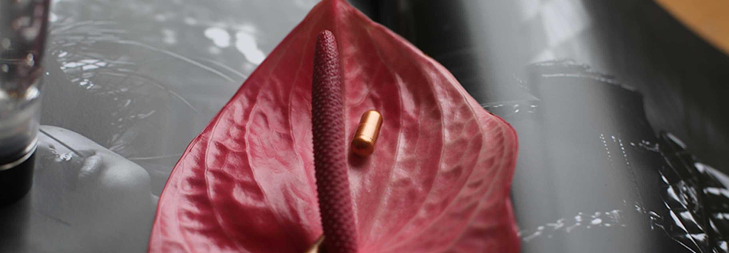 skin tablet in red flower