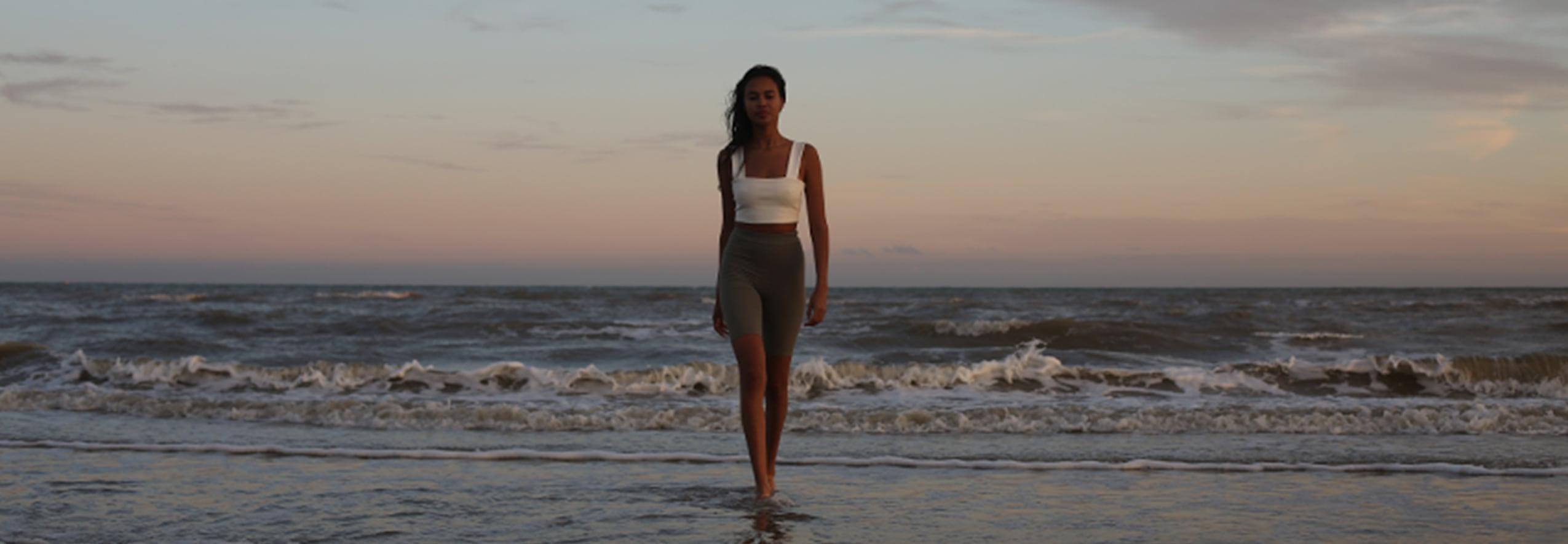 Woman in good health walking on the beach