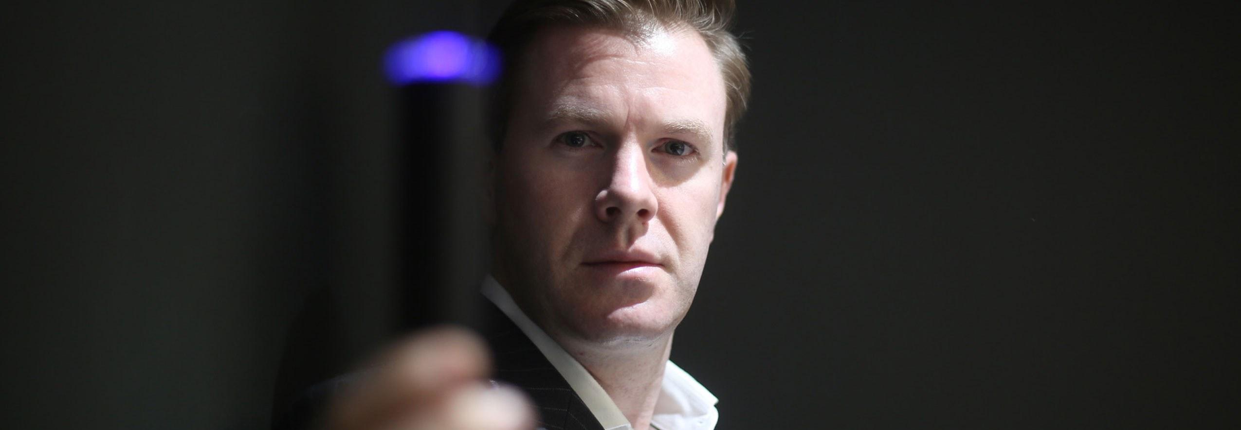 Man holds the LYMA laser