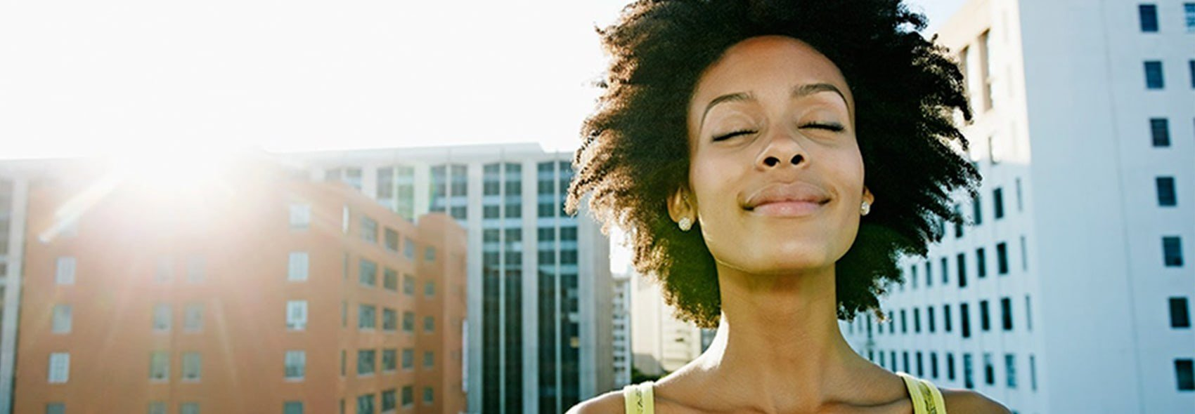 Wellbeing app  afro lady smiling